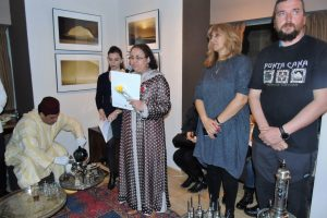 H. E. Mrs. Zakia El Midaoui speaks at the opening of the Tea in the Desert exhibition by Vasil Todev (right)